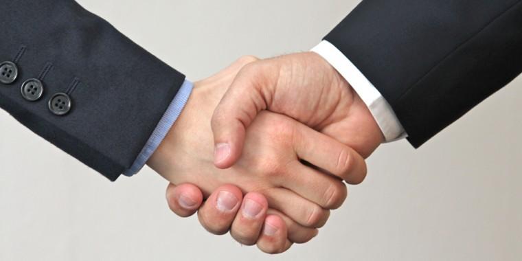 Anwalt Zuerich Vertrag Handschlag
